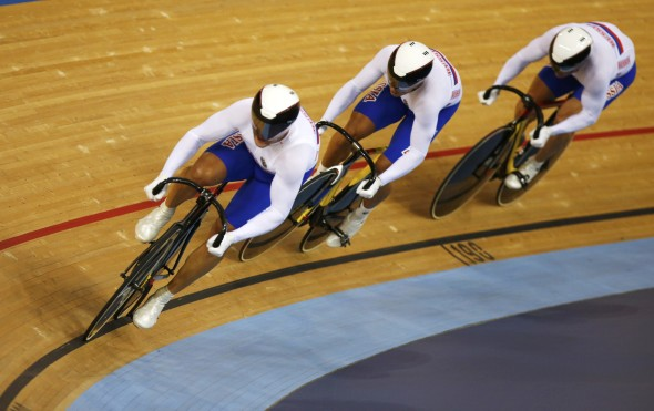 Russia's Sergei Borisov, Denis Dmitriev and Sergey Kocherov compete in the track cycling men's team sprint qualifying heats at the Velodrome during the London 2012 Olympic Games