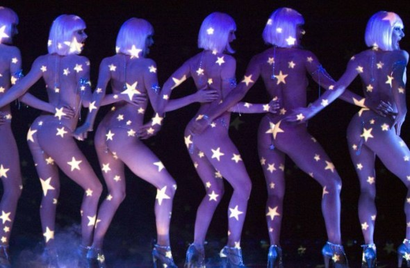 Performers are seen on stage during a rehearsal at the Crazy Horse cabaret in Paris