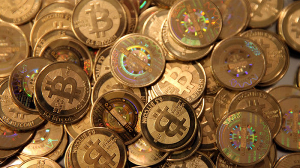1-largest-bitcoin-exchange-suspends-withdrawals-si-1385720188210