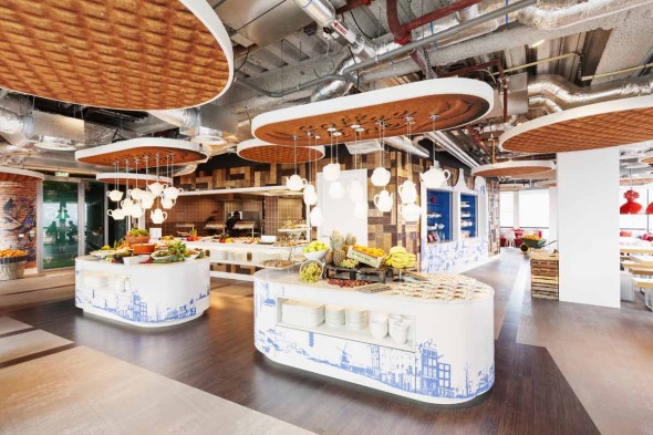 theres-plenty-of-dutch-inspired-design-elements-in-the-kitchen-area-from-the-waffles-and-tea-kettles-hanging-from-the-ceiling-to-the-delft-blue-graphics-on-the-islands