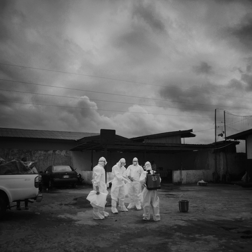 Ebola body removal team getting ready to go in an retrieve the bodies.