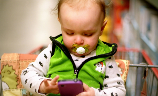 baby_with_phone_DaveLawler_flickr-630x383
