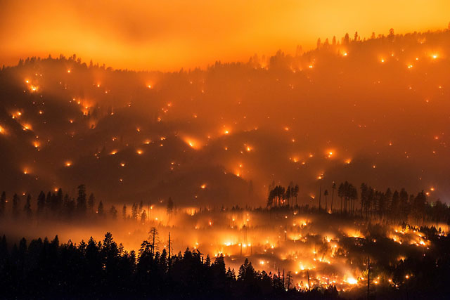 The El Portal Fire burns on a hillside  in the Stanislaus National Forest and Yosemite National Park on Sunday evening July 27, 2014. The community of El Portal was under a mandatory evacuation. By Tuesday the blaze had burned nearly 3,000 acres.  Long exposure image.