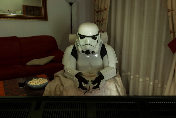 PAY-A-Stormtrooper-sitting-in-the-dark-playing-video-games-with-snacks